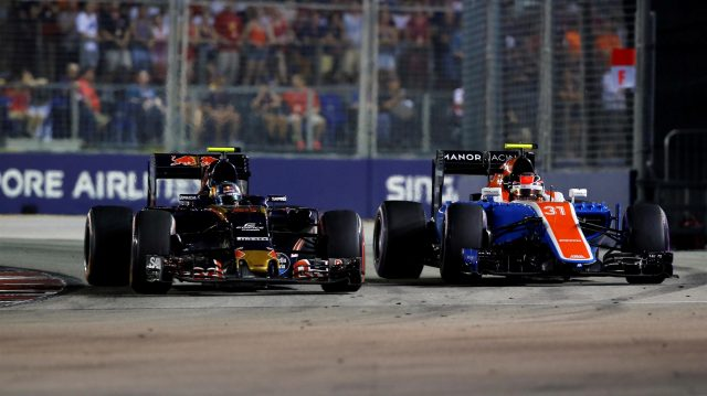 Carlos Sainz (ESP) Scuderia Toro Rosso STR11 and Esteban Ocon (FRA) Manor Racing MRT05 battle at Formula One World Championship, Rd15, Singapore Grand Prix, Race, Marina Bay Street Circuit, Singapore, Sunday 18 September 2016. &copy&#x3b; Sutton Images
