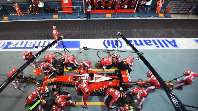 Sebastian Vettel (GER) Ferrari SF16-H pit stop at Formula One World Championship, Rd15, Singapore Grand Prix, Race, Marina Bay Street Circuit, Singapore, Sunday 18 September 2016. &copy&#x3b; Sutton Images