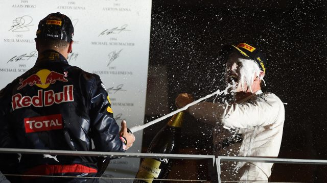 Race winner Nico Rosberg (GER) Mercedes-Benz F1 W07 Hybrid celebrates with Daniel Ricciardo (AUS) Red Bull Racing and the champagne on the podium at Formula One World Championship, Rd15, Singapore Grand Prix, Race, Marina Bay Street Circuit, Singapore, Sunday 18 September 2016. &copy&#x3b; Sutton Images