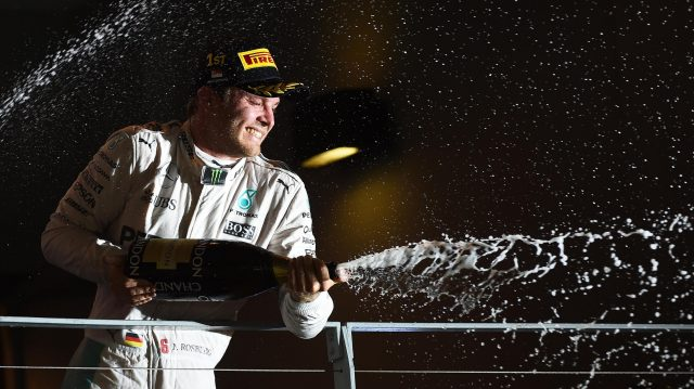 Race winner Nico Rosberg (GER) Mercedes AMG F1 celebrates on the podium with the champagne at Formula One World Championship, Rd15, Singapore Grand Prix, Race, Marina Bay Street Circuit, Singapore, Sunday 18 September 2016. &copy&#x3b; Sutton Images