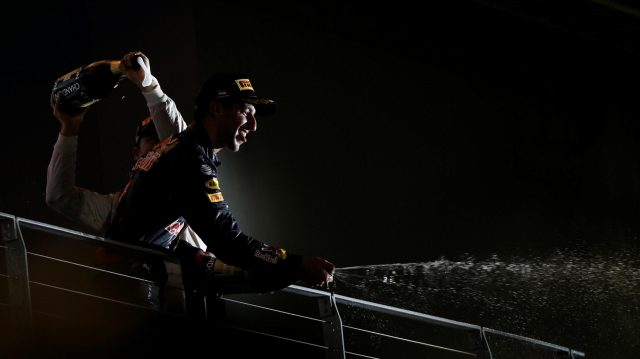 Race winner Nico Rosberg (GER) Mercedes AMG F1 and Daniel Ricciardo (AUS) Red Bull Racing celebrate on the podium with the champagne at Formula One World Championship, Rd15, Singapore Grand Prix, Race, Marina Bay Street Circuit, Singapore, Sunday 18 September 2016. &copy&#x3b; Sutton Images