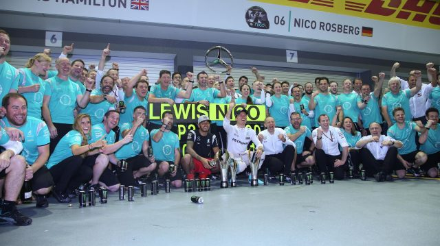 Race winner Nico Rosberg (GER) Mercedes AMG F1 and Lewis Hamilton (GBR) Mercedes AMG F1 celebrate with the team at Formula One World Championship, Rd15, Singapore Grand Prix, Race, Marina Bay Street Circuit, Singapore, Sunday 18 September 2016. &copy&#x3b; Sutton Images