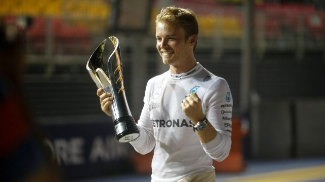 Race winner Nico Rosberg (GER) Mercedes AMG F1 celebrates wit hthe trophy at Formula One World Championship, Rd15, Singapore Grand Prix, Race, Marina Bay Street Circuit, Singapore, Sunday 18 September 2016. &copy&#x3b; Sutton Images