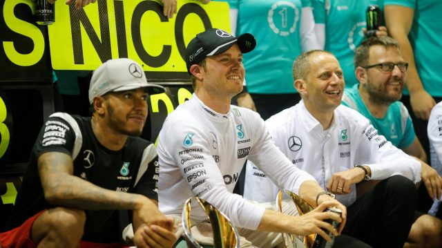 Lewis Hamilton (GBR) Mercedes AMG F1 and Nico Rosberg (GER) Mercedes AMG F1 celebrate with the team and the trophies at Formula One World Championship, Rd15, Singapore Grand Prix, Race, Marina Bay Street Circuit, Singapore, Sunday 18 September 2016. &copy&#x3b; Sutton Images