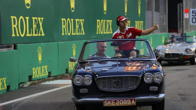 Sebastian Vettel (GER) Ferrari on the drivers parade at Formula One World Championship, Rd15, Singapore Grand Prix, Race, Marina Bay Street Circuit, Singapore, Sunday 18 September 2016. &copy&#x3b; Sutton Images