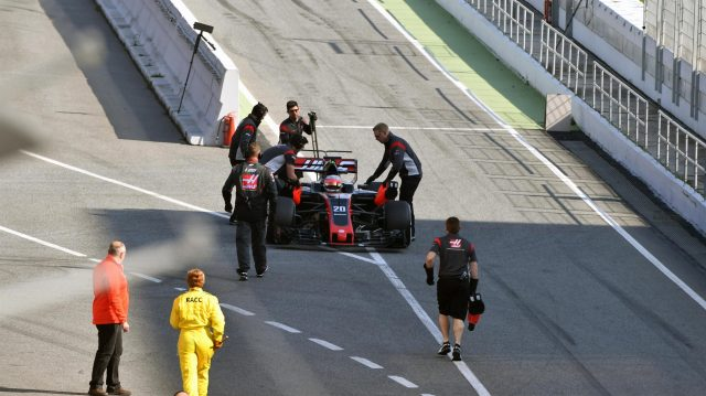 Kevin Magnussen (DEN) Haas VF-17 is pushed by mechanics in pit lane at Formula One Testing, Day One, Barcelona, Spain, 27 February 2017. &copy&#x3b; Sutton Images
