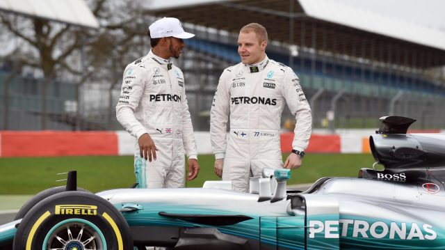 Lewis Hamilton (GBR) Mercedes AMG F1 and Valtteri Bottas (FIN) Mercedes AMG F1 with the new Mercedes-Benz F1 W08 Hybrid at Mercedes-Benz F1 W08 Hybrid Launch, Silverstone, England, 23 February 2017. &copy&#x3b; Sutton Images