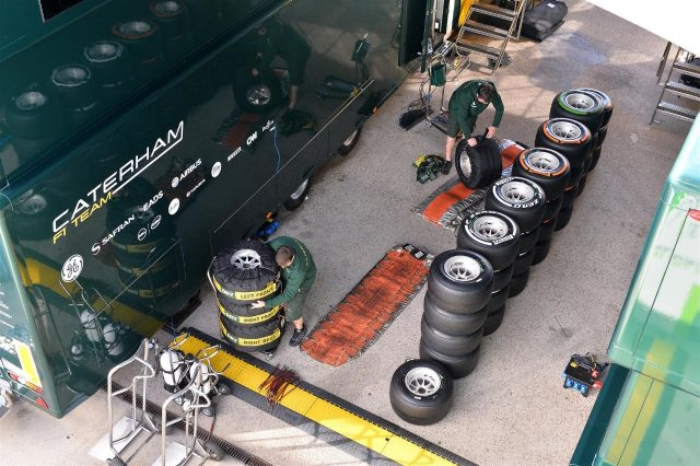 Caterham mechanics and Pirelli tyres. Formula One Testing Preparations, Jerez, Spain, Monday, 27 January 2014. © Sutton Images