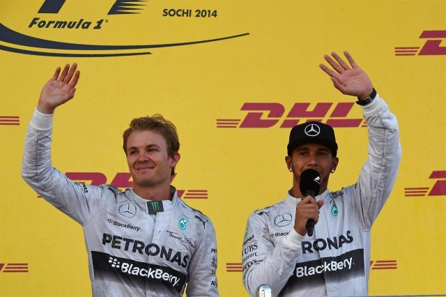 (L to R): Second placed Nico Rosberg (GER) Mercedes AMG F1 and winner Lewis Hamilton (GBR) Mercedes AMG F1 on the podium. Formula One World Championship, Rd16, Russian Grand Prix, Race, Sochi Autodrom, Sochi, Krasnodar Krai, Russia, Sunday, 12 October 2014