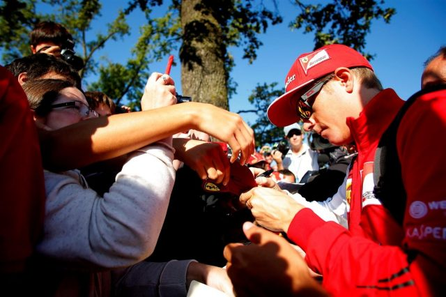 Kimi Raikkonen (FIN) Ferrari arrives at the track and signs autographs for the fans. Formula One World Championship, Rd13, Italian Grand Prix, Monza, Italy, Qualifying, Saturday, 6 September 2014
