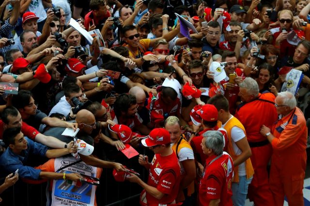Kimi Raikkonen (FIN) Ferrari and Fernando Alonso (ESP) Ferrari sign autographs for the fans. Formula One World Championship, Rd13, Italian Grand Prix, Monza, Italy, Preparations, Thursday, 4 September 2014 © Sutton Images. No reproduction without permission