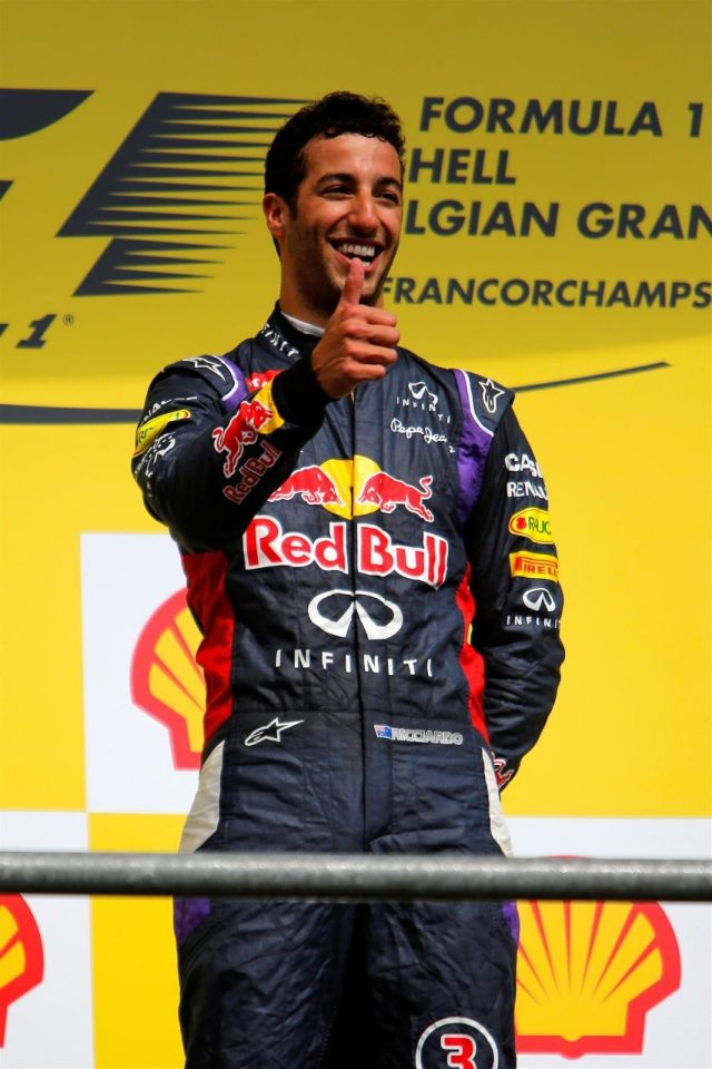 Race winner Daniel Ricciardo (AUS) Red Bull Racing on the podium. Formula One World Championship, Rd12, Belgian Grand Prix, Race Day, Spa-Francorchamps, Belgium, Sunday, 24 August 2014. © Sutton Images