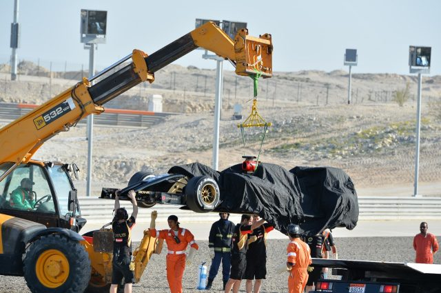 The car of Pastor Maldonado (VEN) Lotus E22 is recovered, Formula One Testing, Day Three, Bahrain International Circuit, Sakhir, Bahrain, Friday, 21 February 2014 © Sutton Images. No reproduction without permission