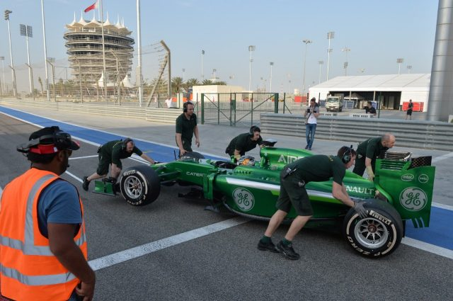 Kamui Kobayashi (JPN) Caterham CT05 stops at the end of pit lane. Formula One Testing, Day One, Bahrain International Circuit, Sakhir, Bahrain, Thursday, 27 February 2014 © Sutton Images. No reproduction without permission