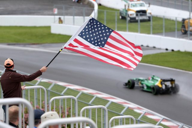 A fan waves the Stars and Stripes for Alexander Rossi (USA) Caterham third driver. Formula One World Championship, Rd7, Canadian Grand Prix, Practice, Montreal, Canada, Friday, 7 June 2013. © Sutton Images