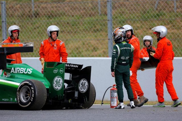 Kamui Kobayashi (JPN) Caterham CT05 crashed. Formula One Testing, Day One, Barcelona, Spain, Tuesday, 13 May 2014. © Sutton Images