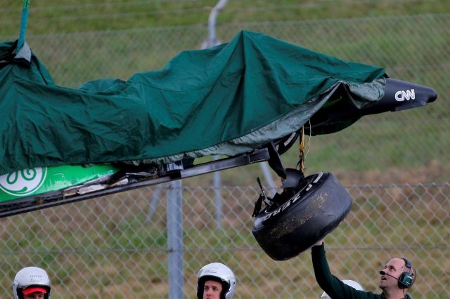 The crashed car of Kamui Kobayashi (JPN) Caterham CT05 is recovered. Formula One Testing, Day One, Barcelona, Spain, Tuesday, 13 May 2014. © Sutton Images