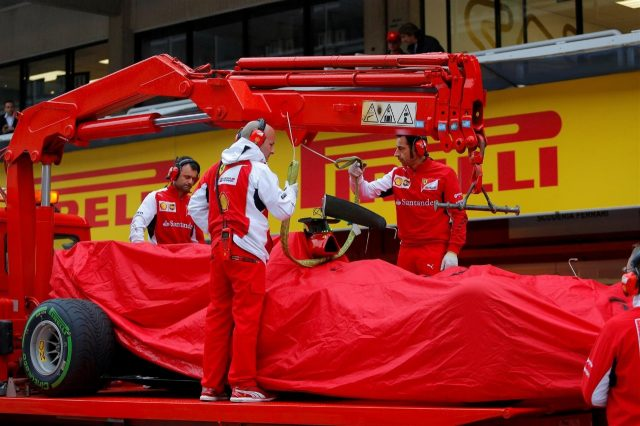 The car of Kimi Raikkonen (FIN) Ferrari F14 T is returned to the pits after stopping on track. Formula One Testing, Day One, Barcelona, Spain, Tuesday, 13 May 2014. © Sutton Images