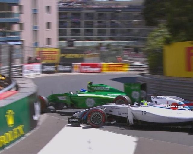Caterham's Marcus Ericsson collides with the Williams of Felipe Massa at Mirabeau, bringing out yellow flags at the end of Q1. © FOWC Ltd