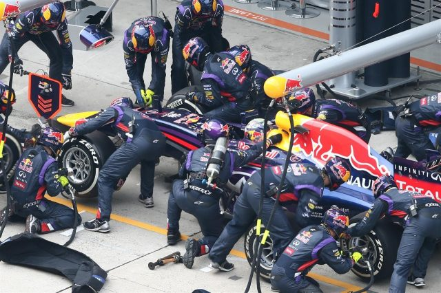 Sebastian Vettel (GER) Red Bull Racing RB10 makes a pit stop. Formula One World Championship, Rd4, Chinese Grand Prix, Race, Shanghai, China, Sunday, 20 April 2014. © Sutton Images