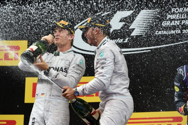 Race winner Lewis Hamilton (GBR) Mercedes AMG F1 celebrates on the podium with Nico Rosberg (GER) Mercedes AMG F1 and the champagne. Formula One World Championship, Rd5, Spanish Grand Prix, Race, Barcelona, Spain, Sunday, 11 May 2014. © Sutton Images