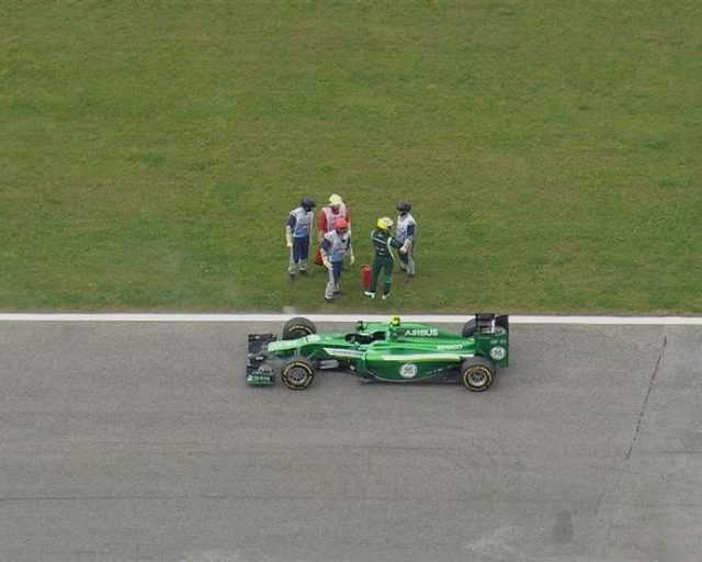Marcus Ericsson's Caterham stops on track on the exit of Turn 1 after just 25 minutes of FP1. © FOWC Ltd