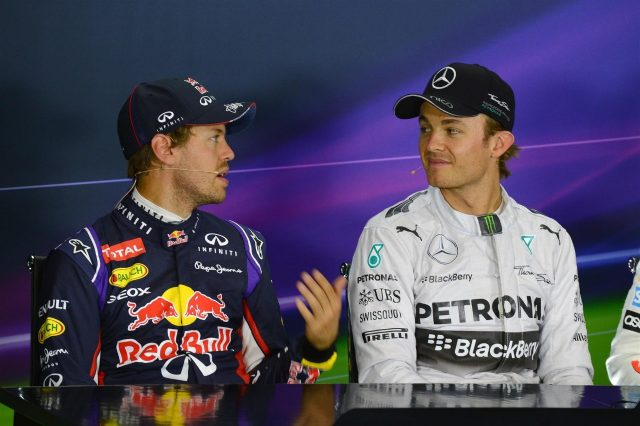 Sebastian Vettel (GER) Red Bull Racing and Nico Rosberg (GER) Mercedes AMG F1 in the Press Conference. Formula One World Championship, Rd9, British Grand Prix, Qualifying, Silverstone, England, Saturday, 5 July 2014