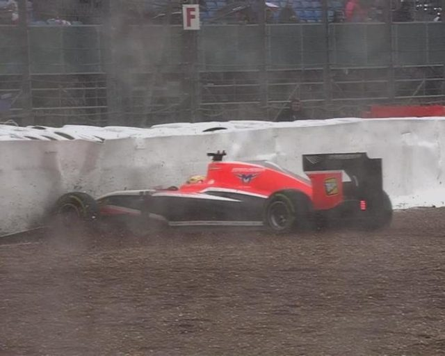 The weather claims another victim. This time it's the Marussia of Jules Bianchi that leaves the track and slides into the tyre wall. © FOWC Ltd