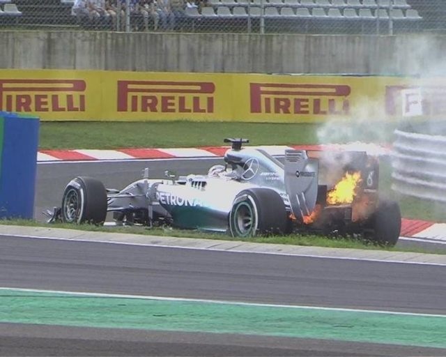 Lewis Hamilton's qualifying hopes go up in flames as he is forced out in the early stages of Q1, moments after Lotus's Pastor Maldonado also pulls off the circuit and out of the session. © FOWC Ltd