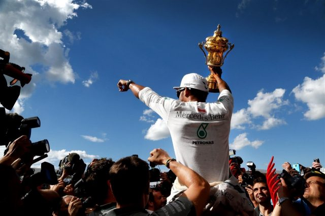 Race winner Lewis Hamilton (GBR) Mercedes AMG F1 celebrates with the trophy. Formula One World Championship, Rd9, British Grand Prix, Race Day, Silverstone, England, Sunday, 6 July 2014