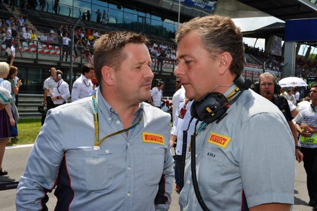(L to R): Paul Hembery (GBR) Pirelli Motorsport Director and Mario Isola (ITA) Pirelli Sporting Director. Formula One World Championship, Rd8, Austrian Grand Prix, Race, Spielberg, Austria, Sunday, 22 June 2014