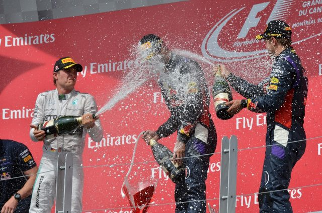 (L to R): Nico Rosberg (GER) Mercedes AMG F1, Daniel Ricciardo (AUS) Red Bull Racing and Sebastian Vettel (GER) Red Bull Racing celebrate on the podium with the champagne.