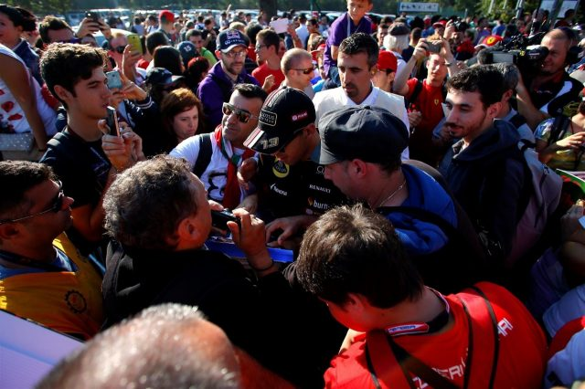 Pastor Maldonado (VEN) Lotus arrives at the track and signs autographs for the fans. Formula One World Championship, Rd13, Italian Grand Prix, Monza, Italy, Qualifying, Saturday, 6 September 2014