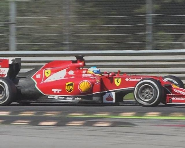 Ferrari's Fernando Alonso is the first driver out on the medium compound tyre and vaults into second, to the delight of the tifosi. © FOWC Ltd