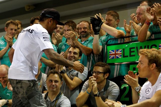 Race winner Lewis Hamilton (GBR) Mercedes AMG F1 celebrates with the team. Formula One World Championship, Rd14, Singapore Grand Prix, Marina Bay Street Circuit, Singapore, Race Day, Sunday, 21 September 2014