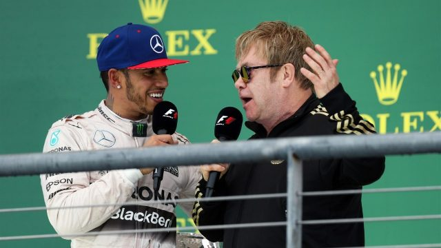 Race winner and new World Champion Lewis Hamilton (GBR) Mercedes AMG F1 celebrates on the podium with Elton John (GBR) at Formula One World Championship, Rd16, United States  Grand Prix, Race, Austin, Texas, USA, Sunday 25 October 2015. &copy&#x3b; Sutton Motorsport Images
