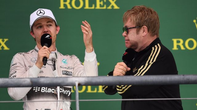 Nico Rosberg (GER) Mercedes AMG F1 celebrates on the podium with Elton John (GBR) at Formula One World Championship, Rd16, United States  Grand Prix, Race, Austin, Texas, USA, Sunday 25 October 2015. &copy&#x3b; Sutton Motorsport Images