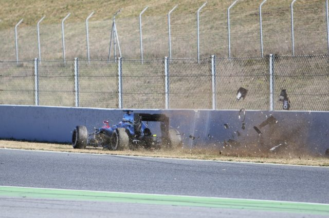 Fernando Alonso (ESP) McLaren MP4-30 crashes at Formula One Testing, Day Four, Barcelona, Spain, 22 February 2015.