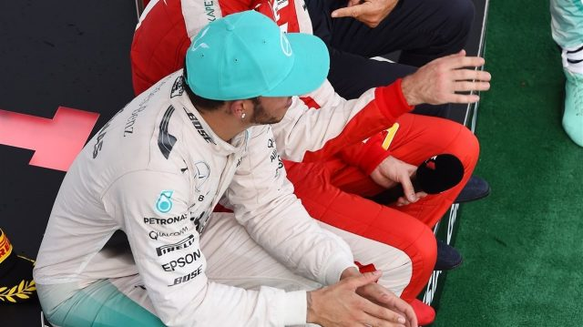 Lewis Hamilton (GBR) Mercedes AMG F1 and Sebastian Vettel (GER) Ferrari sit down on the podium with Eddie Jordan (IRE) BBC Television Pundit at Formula One World Championship, Rd2, Malaysian Grand Prix, Race, Sepang, Malaysia, Sunday 29 March 2015. &copy&#x3b; Sutton Motorsport Images