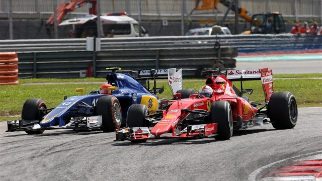 Sebastian Vettel (GER) Ferrari SF15-T and Felipe Nasr (BRA) Sauber C34 battle at Formula One World Championship, Rd2, Malaysian Grand Prix, Race, Sepang, Malaysia, Sunday 29 March 2015. &copy&#x3b; Sutton Motorsport Images