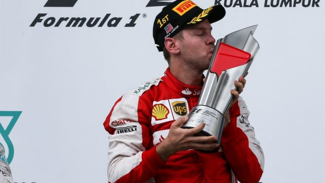 Race winner Sebastian Vettel (GER) Ferrari celebrates on the podium with the trophy at Formula One World Championship, Rd2, Malaysian Grand Prix, Race, Sepang, Malaysia, Sunday 29 March 2015. &copy&#x3b; Sutton Motorsport Images
