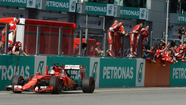 Race winner Sebastian Vettel (GER) Ferrari SF15-T crosses the line Formula One World Championship, Rd2, Malaysian Grand Prix, Race, Sepang, Malaysia, Sunday 29 March 2015. &copy&#x3b; Sutton Motorsport Images