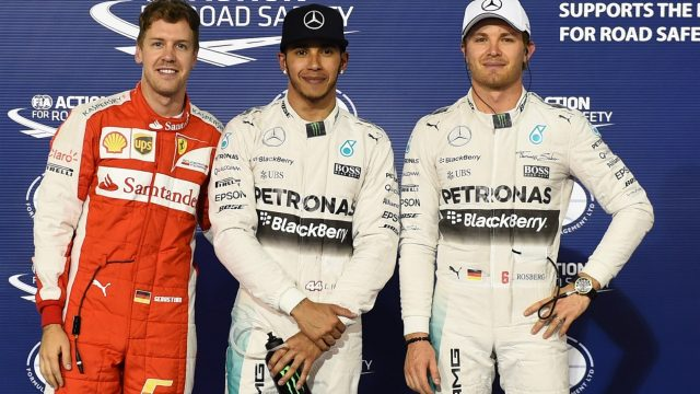 (L to R): Sebastian Vettel (GER) Ferrari, pole sitter Lewis Hamilton (GBR) Mercedes AMG F1 and Nico Rosberg (GER) Mercedes AMG F1 in parc ferme at Formula One World Championship, Rd4, Bahrain Grand Prix Qualifying, Bahrain International Circuit, Sakhir, Bahrain, Saturday 18  April 2015. &copy&#x3b; Sutton Motorsport Images