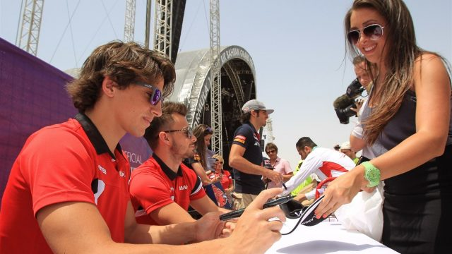 Roberto Merhi (ESP) and Will Stevens (GBR) Marussia signs autographs for the fans at Formula One World Championship, Rd4, Bahrain Grand Prix Qualifying, Bahrain International Circuit, Sakhir, Bahrain, Saturday 18  April 2015. &copy&#x3b; Sutton Motorsport Images