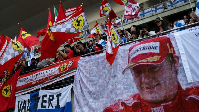 Kimi Raikkonen (FIN) Ferrari fans with flags on the main grandstand at Formula One World Championship, Rd3, Chinese Grand Prix, Race, Shanghai, China, Sunday 12 April 2015. &copy&#x3b; Sutton Motorsport Images
