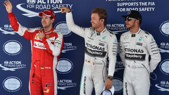 (L to R): Sebastian Vettel (GER) Ferrari, pole sitter Nico Rosberg (GER) Mercedes AMG F1 and Lewis Hamilton (GBR) Mercedes AMG F1 celebrate in parc ferme at Formula One World Championship, Rd5, Spanish Grand Prix Qualifying, Barcelona, Spain, Saturday 9 May 2015. &copy&#x3b; Sutton Motorsport Images