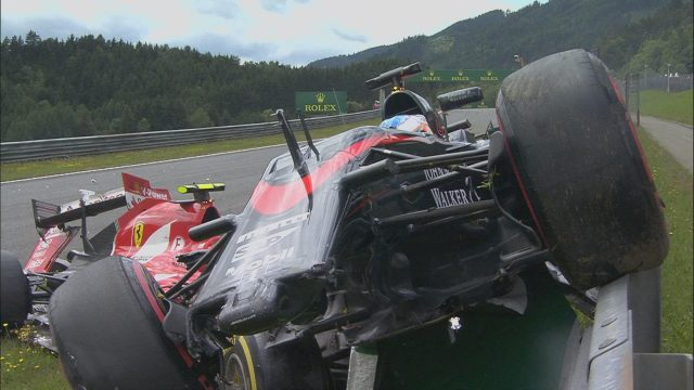 McLaren's Fernando Alonso and Ferrari's Kimi Raikkonen collide on the opening lap in Austria &copy&#x3b; FOWC Ltd