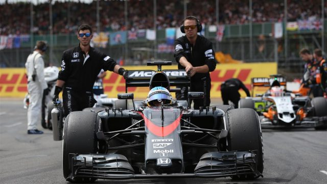 Fernando Alonso (ESP) McLaren MP4-30 on the grid at Formula One World Championship, Rd9, British Grand Prix, Race, Silverstone, England, Sunday 5 July 2015. &copy&#x3b; Sutton Motorsport Images