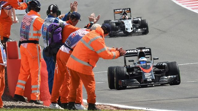 Fernando Alonso (ESP) McLaren MP4-30 passes the marshals at the end of the race at Formula One World Championship, Rd9, British Grand Prix, Race, Silverstone, England, Sunday 5 July 2015. &copy&#x3b; Sutton Motorsport Images