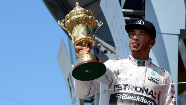 Race winner Lewis Hamilton (GBR) Mercedes AMG F1 celebrates in with the trophy on the podium at Formula One World Championship, Rd9, British Grand Prix, Race, Silverstone, England, Sunday 5 July 2015. &copy&#x3b; Sutton Motorsport Images